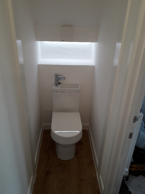 New toilet under stairs